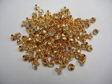 143 swarovski rhinestone rivets/w 24ss crystal AB stone,goldplated