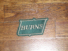 burns security patch,new old stock, 70's   green backround