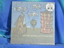 Modest Mouse - Building Nothing Out Of Something, lim. red LP, MP3, neu/OVP