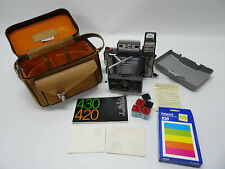 POLAROID 420 LAND CAMERA WITH LEATHER CASE, MANUAL, FLASH AND EXTRAS