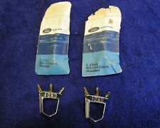 1955 FORD AND 1955 , 1956 THUNDERBIRD NOS PAIR OF FENDER EMBLEM RETAINERS.