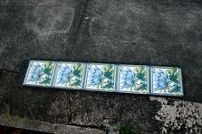 A set of 5 authentic Victorian fireplace tiles (one broke) in the original tray