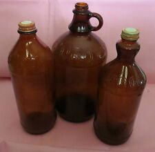 Three Amber Glass Clorox Bottles