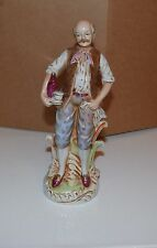 Antiques Vintage porcelain figurine of a man with a bottle of wine and cup10.5""