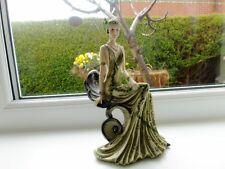 Seated Lady Figurine In Art Deco Period Green Flapper Dress