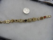 Vintage stunning gold tone charm slide bracelet #3073