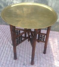Persian Islamic brass topped folding table, with engraved circular tray.