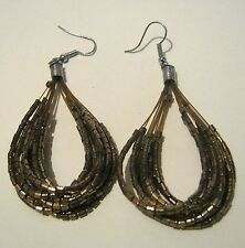 Gorgeous silver tone metal fixing earing with multiple gold coloured beads