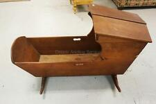 ANTIQUE DOVETAILED CRADLE WITH BONNET. 41 INCHES LONG. 25 1/2 INCHES... Lot 1077