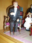 Dolls house figure 1/12th scale Poly/Resin Vicar sitting DP312