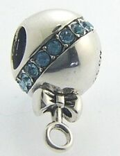 2025-1071  CHAMILIA STERLING SILVER RATTLE ON BLUE CHARM NEW WITH POUCH
