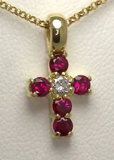 VIBRANT RED 18CARAT YELLOW GOLD DIAMOND AND RUBY CLAW SET CROSS PENDANT .