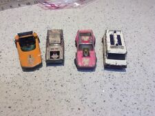 Four Vintage Toy Vehicles