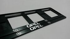 2X OPEL EUROPEAN LICENSE NUMBER PLATE SURROUND FRAME HOLDER.