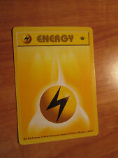 NM 1st edition LIGHTNING ENERGY Pokemon Card BASE Set 100/102 Common Shadowless
