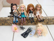 Bratz doll lot of 4 girls dolls dressed with extras ,styling head ,dog+