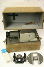 Argus model 200 2 x 2 slide projector w/two carriesr, new lamp and case