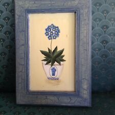 Primitive painting on board of flower in pot