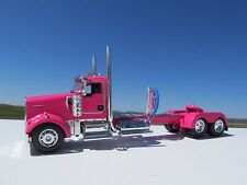 DCP 1/64 SCALE W900 KENWORTH DAY CAB PINK, LONG WHEEL BASE , WTI FENDERS