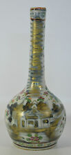 An 18th century Chinese porcelain clobbered canton blue and white bottle vase