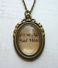 "Bronze Alice in Wonderland ""We're All Mad Here"" Glass Necklace New in Gift Bag"