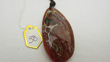 A CRAZY LACE AGATE PENDANT ON A WAXED CORD NECKLACE.  (38)