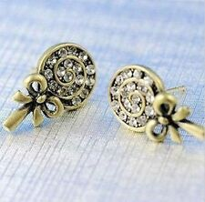 Cute gold coloured lollipop stud earrings with crystal
