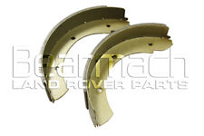 Land Rover Defender Handbrake Shoe Set (early rod type) to 94 - Bearmach Parts