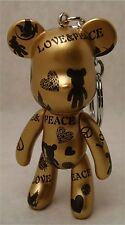 "POPOBE 3""key chain love and peace gold  body  and black logos bear"