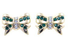 Gold tone bow stud earrings with blue and clear crystal
