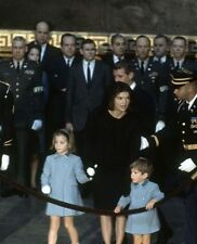 John F. Kennedy's family standing in the U.S. Capital at his funeral.