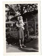 Vintage snapshot girl young teen baby bobby socks saddle shoes wire fence WI.