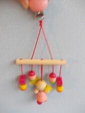 Houten baby speelgoed met klip om op maxi cosy te knijpen