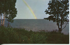 OLD POST CARD OF UNIDENTIFIED LAKE IN NORTHERN  MINNESOTA WITH A RAINBOW