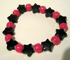 Lovely Bracelet with shocking pink round beads & black star beads elasticated
