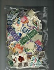 A group of  1000 worldwide used stamps collection off paper some duplicates