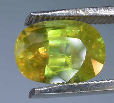 """""""COLOR CHANGE MULTI-COLOR FLASH OVAL CUT YELLOWISH GREEN SPHENE  2.30 CT."""