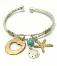 Silvertone adjustable bracelet with Starfish, sand dollar and heart charms