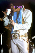 ELVIS PRESLEY IN SUNDIAL SUIT WITH TCB RING GREENSBORO NC 4/21/77 PHOTO CANDID