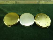 Three Stratton compact  engine turned designs two goldtone one silvertone