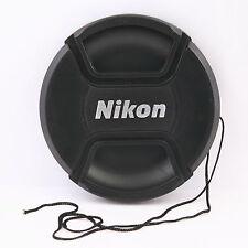 Tapa delantera 62mm con cordón y pinza central para objetivo Nikon