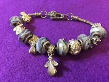 Lovely European Charms & Faceted Swirl Glass Beads Bracelet.