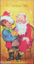 "Greeting card ""A CHRISTMAS WISH"" Boy sits on Santa's lap and wears his hat"