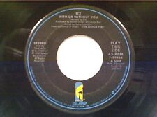 "U2 ""WITH OR WITHOUT YOU / LUMINOUE TIMES / WALK TO THE WATER"" 45"