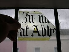 F492 - antique stained glass window fragment - part of an inscription - 'Abbey'