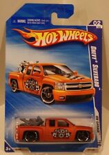 2010 Hot Wheels HW Garage Chevy Silverado w/Bike in back Matte Orange