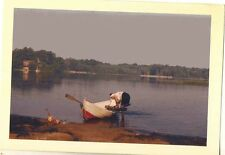 Old Vintage Photograph Woman Bending Over Red and White Canoe in Lake 1960