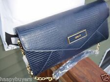 NEW WITH TAG DKNY  NAVY  LEATHER LARGE CLUTCH.Retail $200.00.100%GENUINE