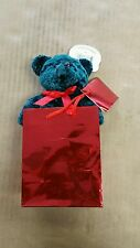 Plush pals green bear in red gift bag
