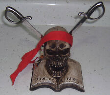 PIRATES OF THE CARIBBEAN CURSE OF THE BLACK PEARL RESIN SKULL & SWORD PH0118